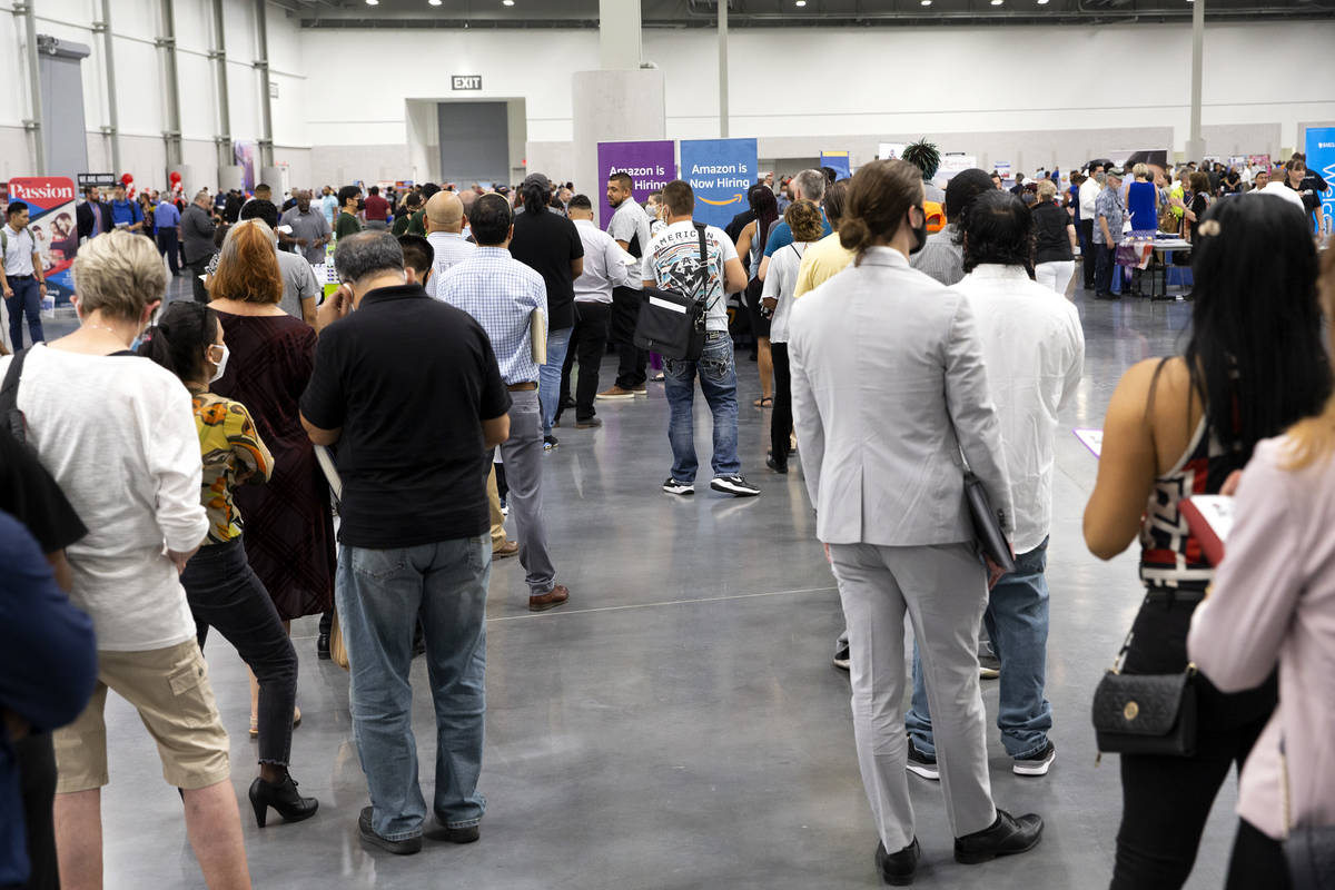 Job-seekers wait in line for the Amazon booth during a summer job fair hosted by Clark County a ...