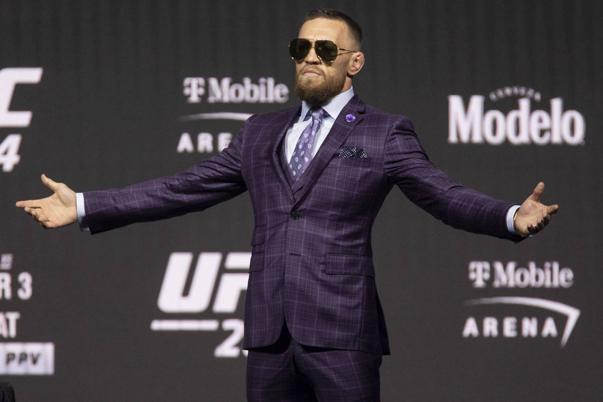 Conor McGregor takes the stage for an UFC 264 press conference at T-Mobile Arena in Las Vegas, ...