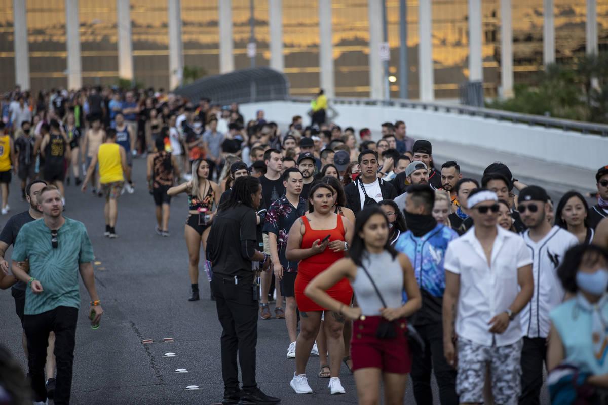 People line up on the Hacienda Avenue bridge to enter Allegiant Stadium in Las Vegas for the Il ...