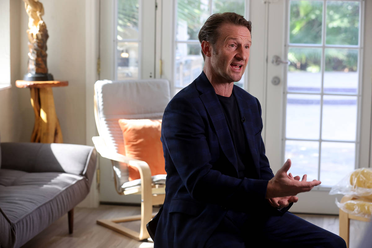 Former Olympian and former Cirque du Soleil performer Paul Bowler talks to a reporter at his La ...