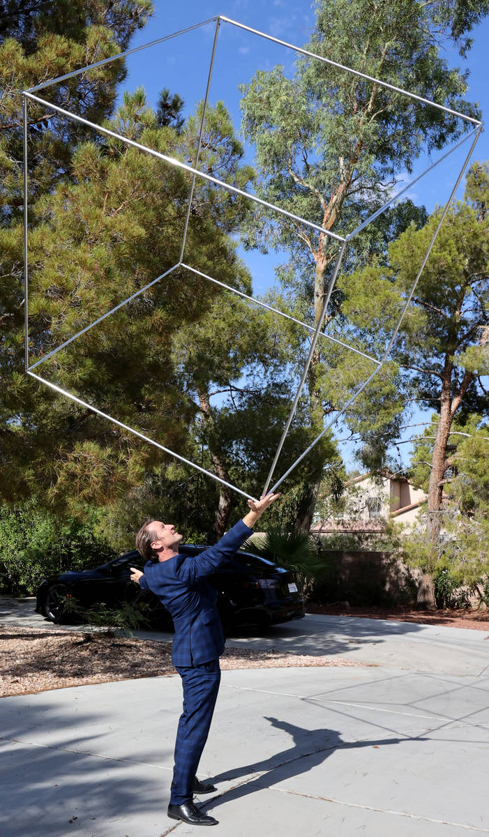 Former Olympian and former Cirque du Soleil performer Paul Bowler spins a cube used in his act ...