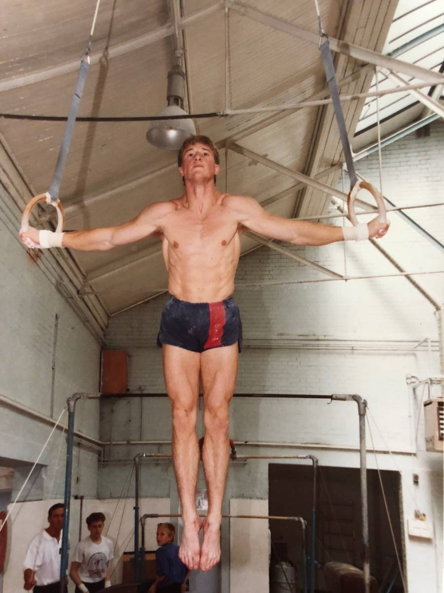 Paul Bowler, then about 20, practices rings at Gorton Gymnastic Centre in Manchester, England. ...