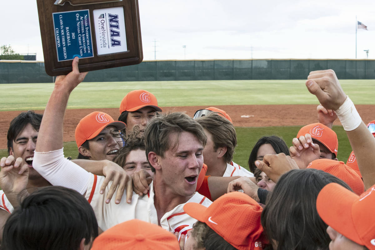Bishop Gorman High's right fielder Tyler Whitaker joins his teammates as they celebrate their v ...