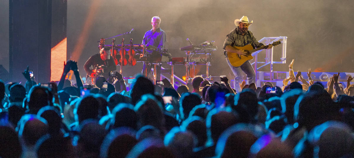 Garth Brooks performs before the crowd at Allegiant Stadium on Friday, July 10 2021, in Las Veg ...