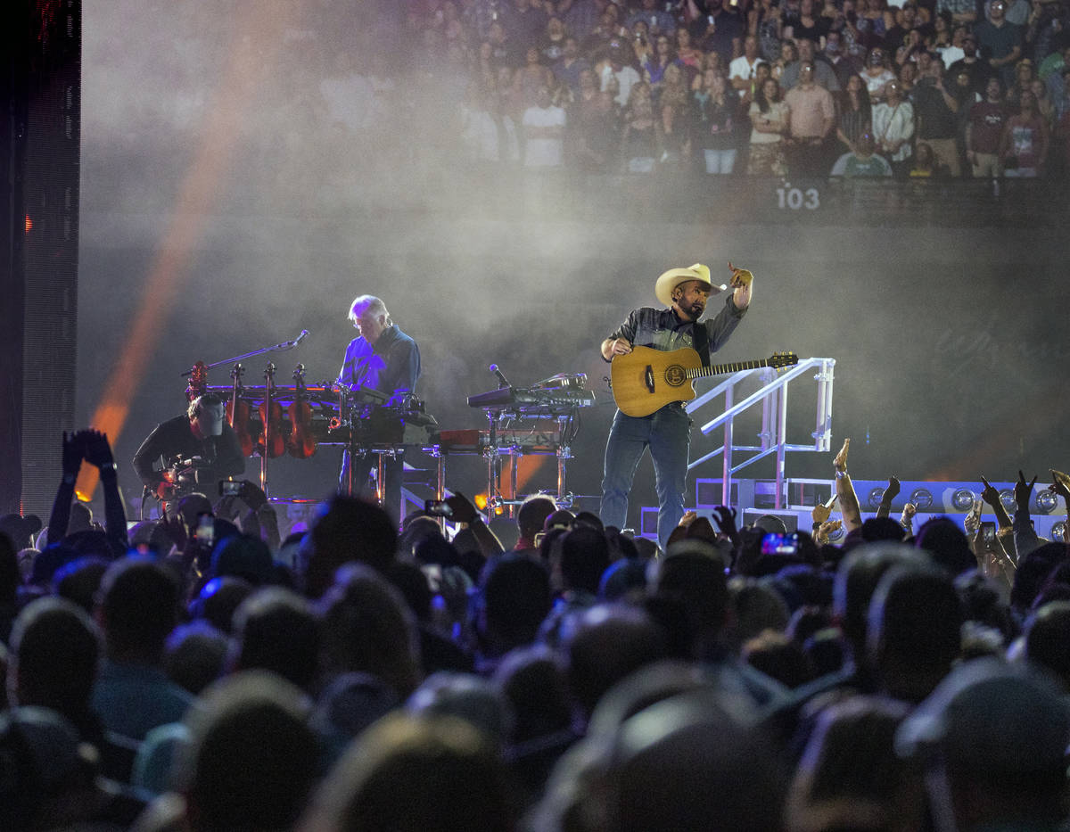 Garth Brooks signals the fans as he performs before the crowd at Allegiant Stadium on Friday, J ...