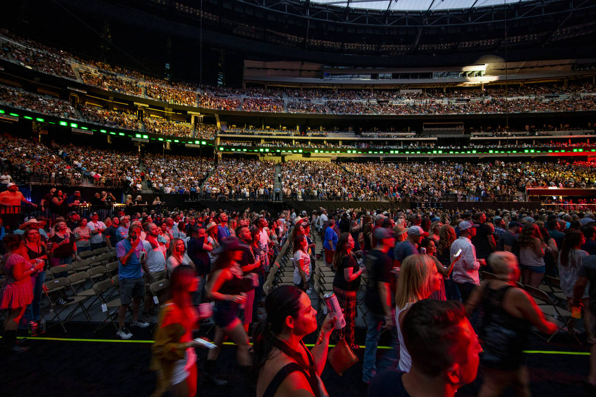 Fans enjoy the music and refreshments as Garth Brooks performs before the crowd at Allegiant St ...