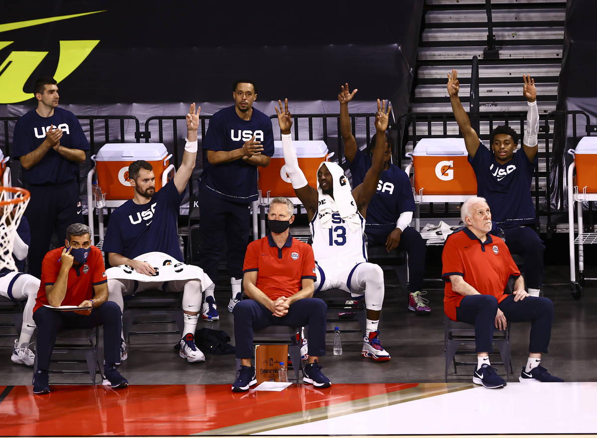 USA Basketball players celebrate a three-pointer by Jerami Grant, not pictured, during the firs ...