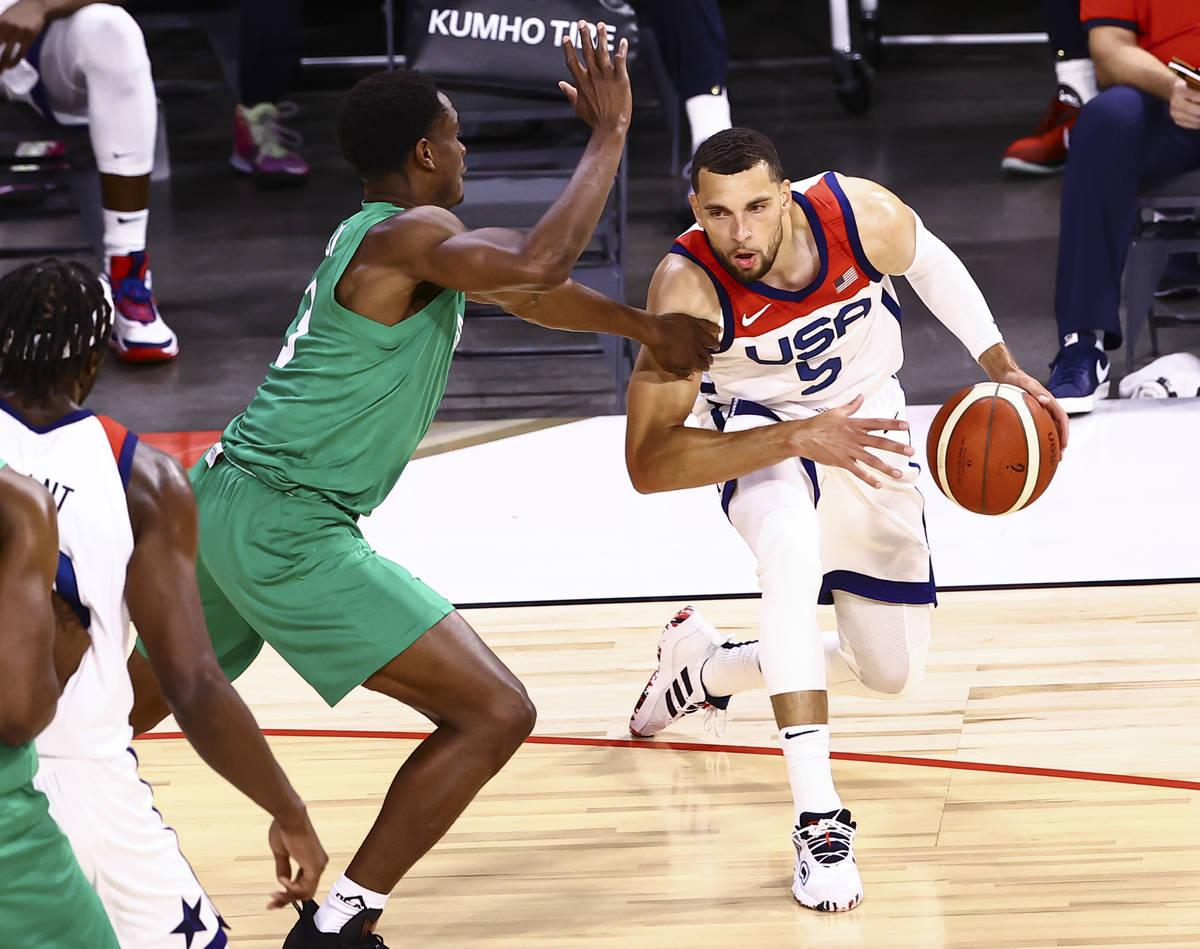 USA Basketball's Zach Lavine (5) drives the ball around Nigeria's Caleb Agada (3) during ...