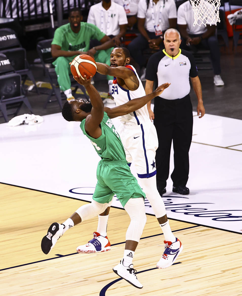 USA Basketball's Kevin Durant (7) blocks a shot from Nigeria's Ike Nwamu (34) during the ...