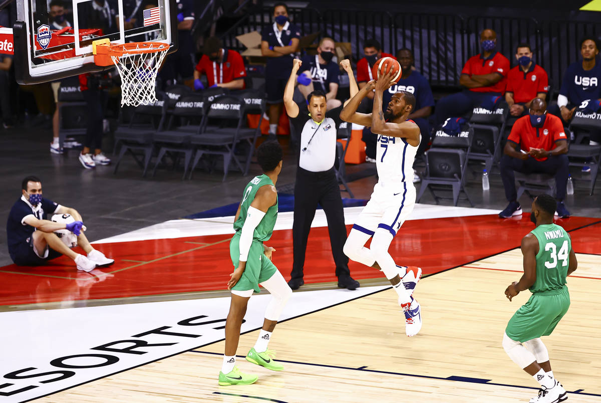 USA Basketball's Kevin Durant (7) shoots over Nigeria's KZ Okpala (0) during the first h ...