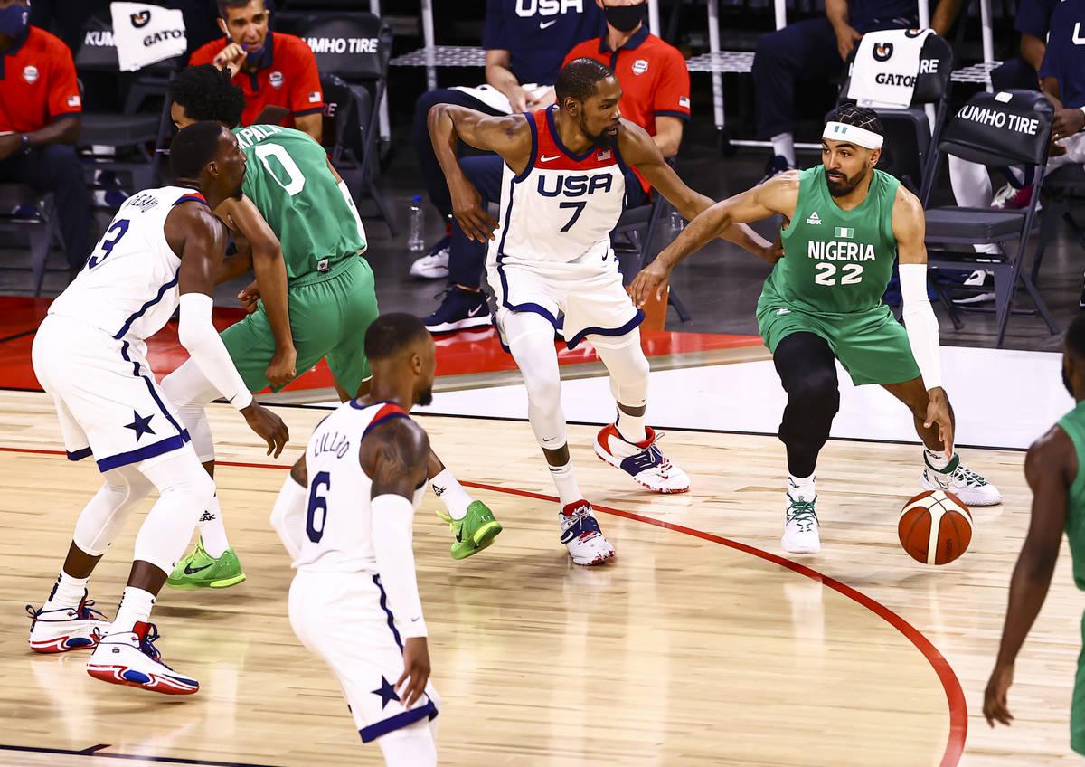 NigeriaÕs Gabe Nnamdi Vincent (22) drives the ball under pressure from USA Basketball's Ke ...