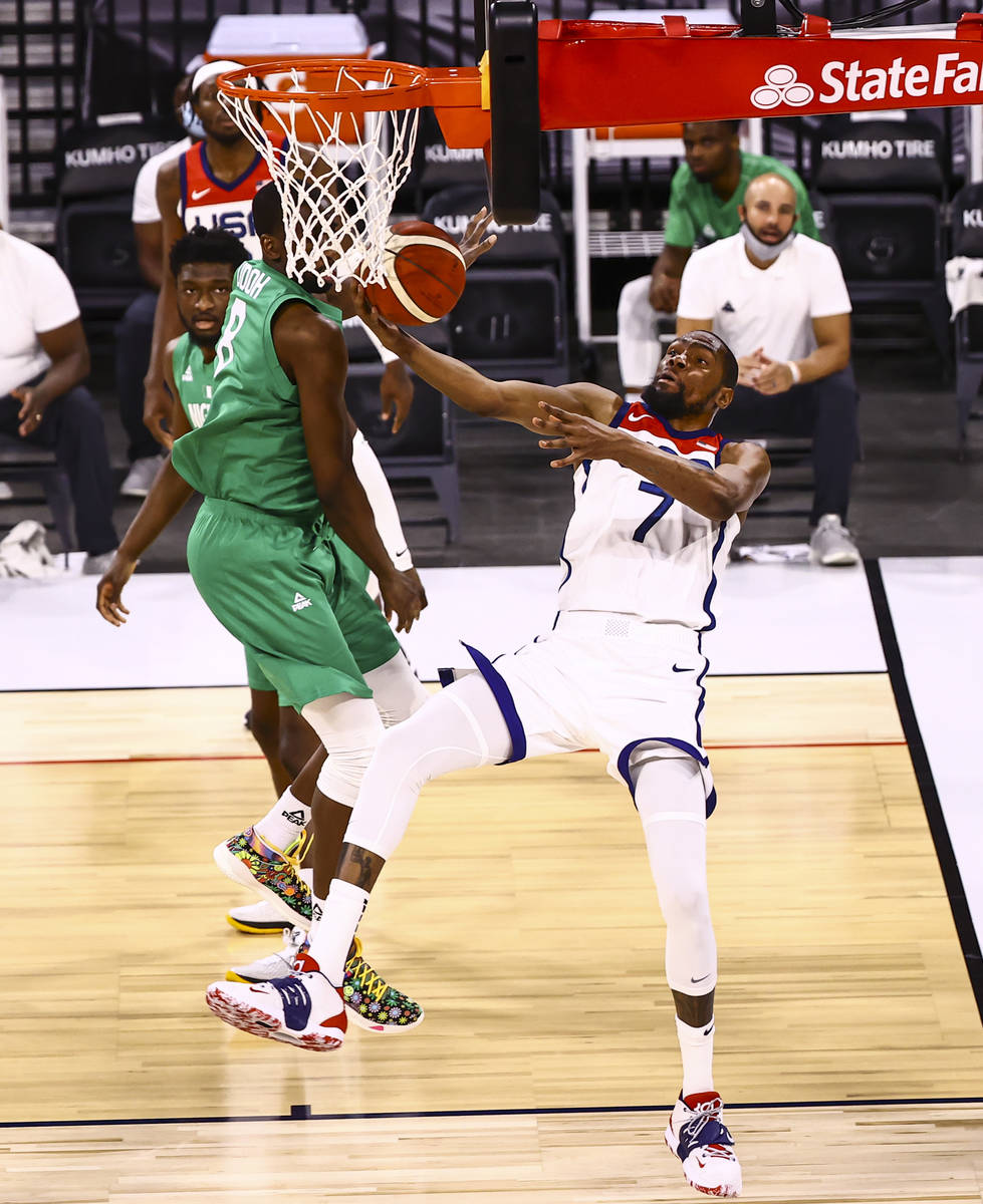 USA Basketball's Kevin Durant (7) gets fouled by Nigeria's Ekpe Udoh (8) during the seco ...