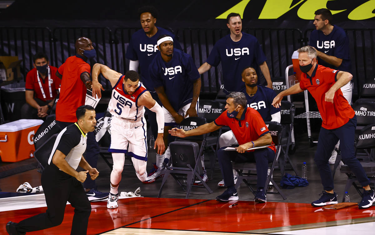 Zach Lavine (5) runs back onto the court after keeping the ball out of bounds and passing to a ...