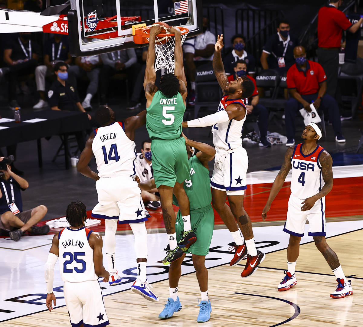 NigeriaÕs Stanley Okoye (5) dunks against USA during the second half of an exhibition game ...