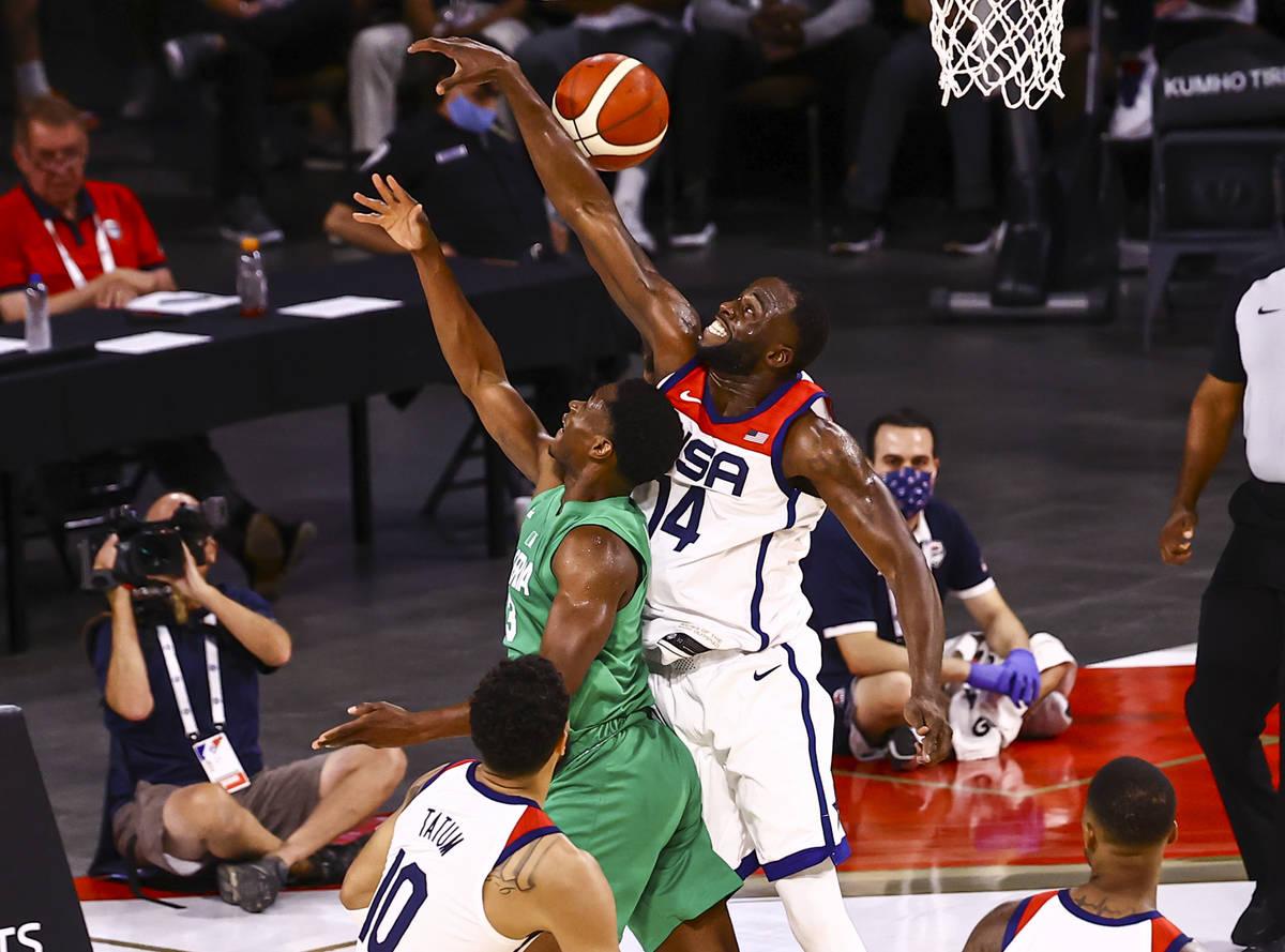 USA Basketball's Draymond Green (14) defends as Nigeria Caleb Agada (3) goes to the basket duri ...