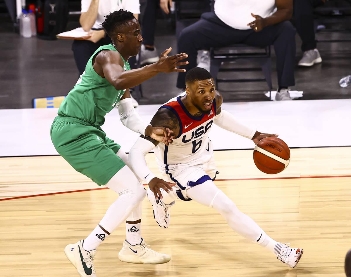 USA Basketball's Damian Lillard (6) drives the ball under pressure from Nigeria's Miye O ...