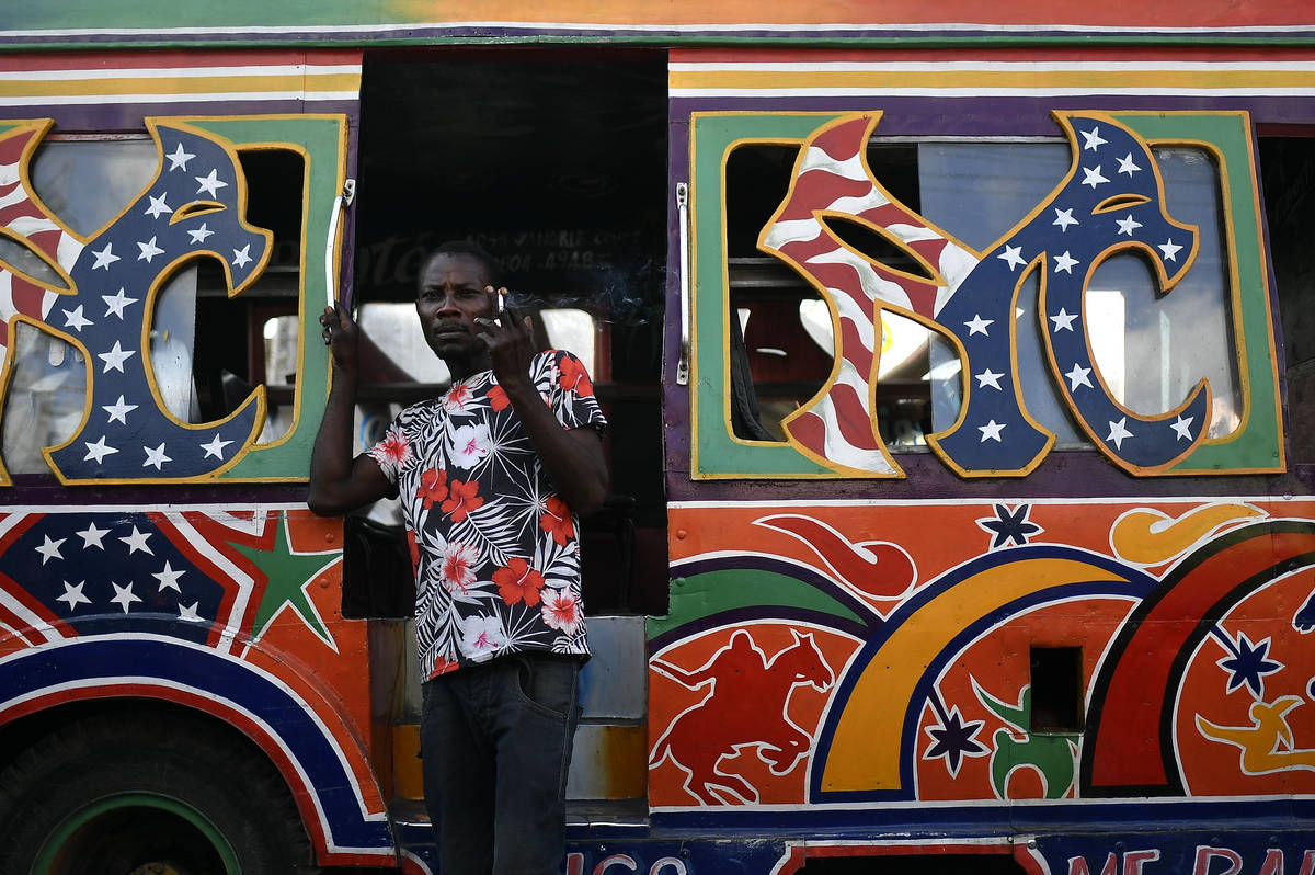 A worker waits for customers at a bus terminal in Port-au-Prince, Haiti, Saturday, July 10, 202 ...