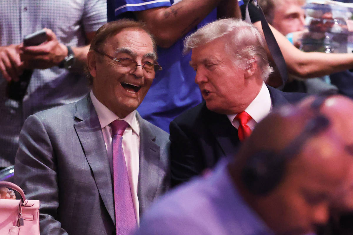 Phil Ruffin, owner of the Treasure Island, and Former President Donald Trump attend UFC 264 at ...