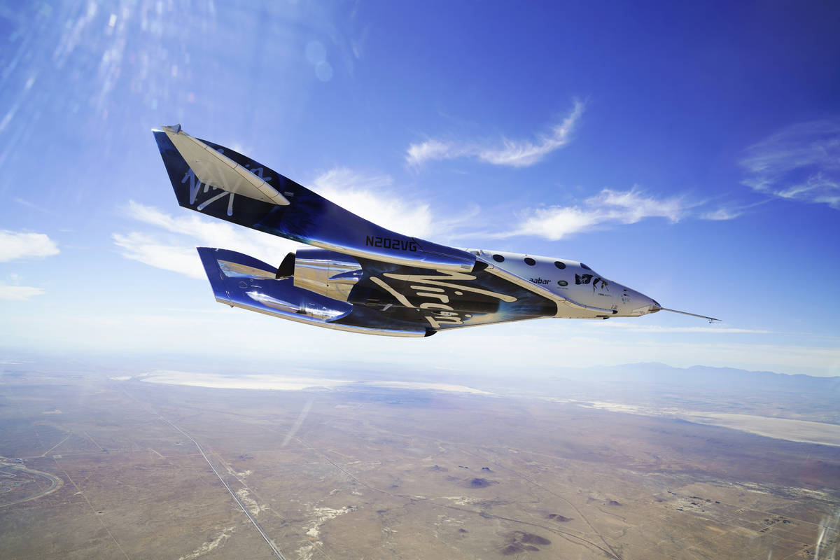 This May 29, 2018 photo made available by Virgin Galactic shows the company's VSS Unity on its ...