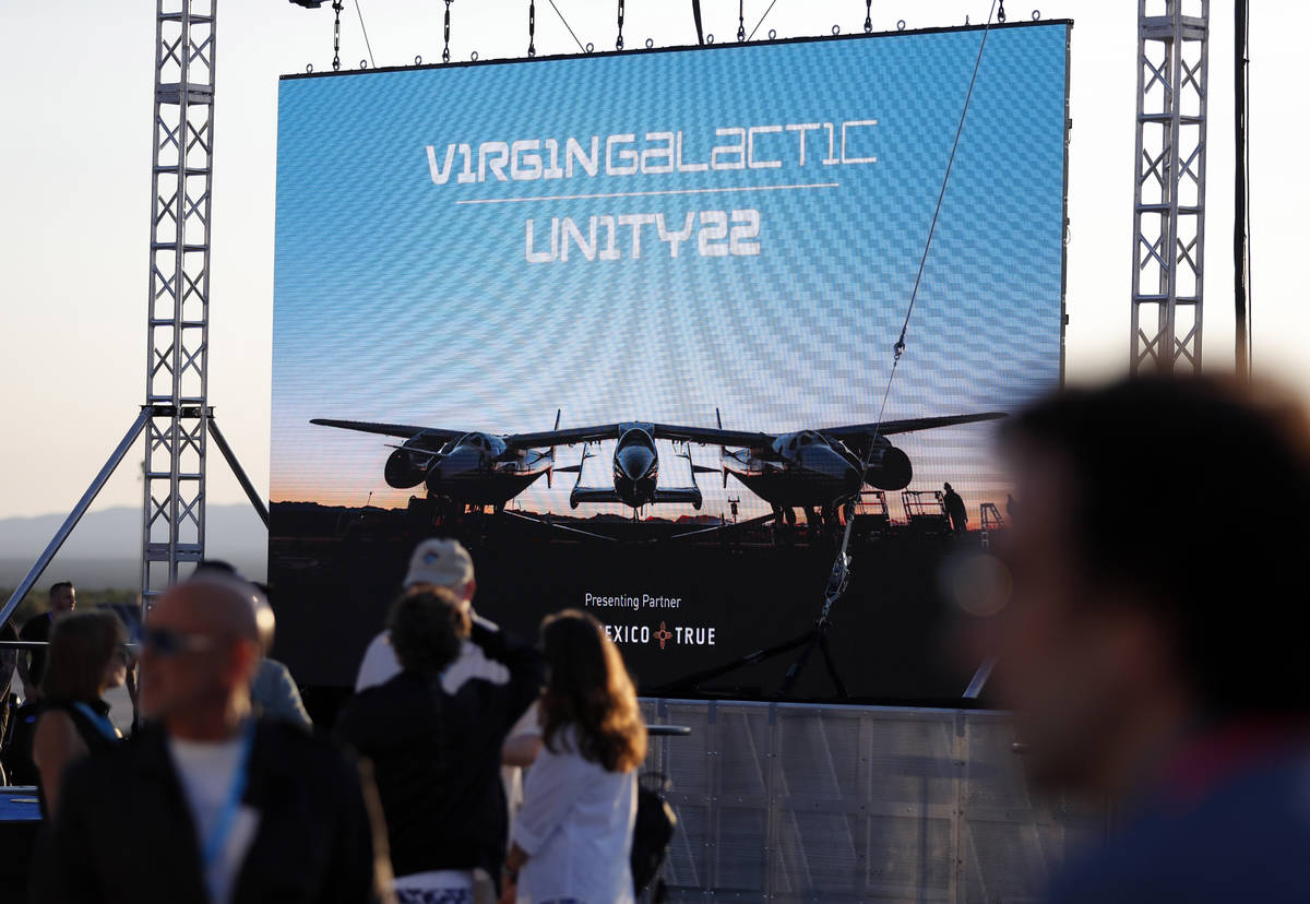 Special guests chat as they wait for Virgin Galactic founder Richard Branson's launch to space ...