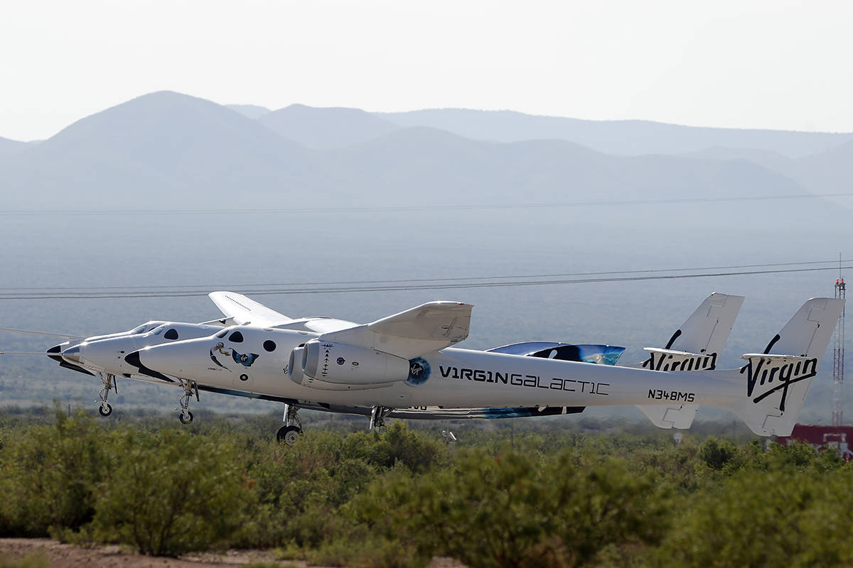 The rocket plane carrying Virgin Galactic founder Richard Branson and other crew members takes ...