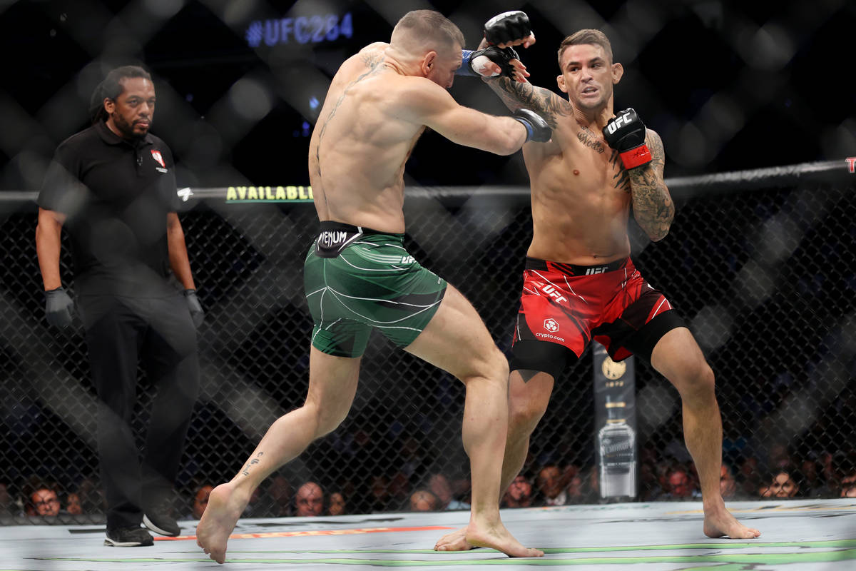 Conor McGregor, left, and Dustin Poirier, battles in the first round of a lightweight bout agai ...