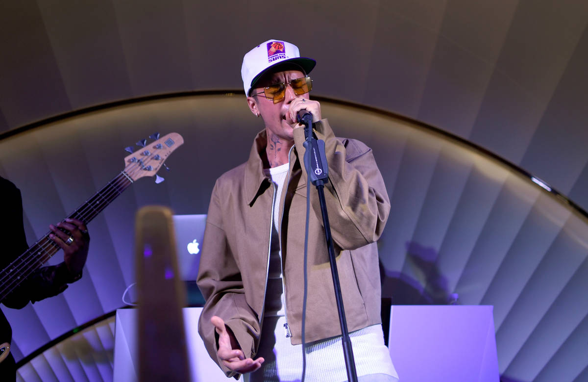 Justin Bieber performs onstage at h.wood Group's grand openingof Delilah at Wynn Las Vegas on ...