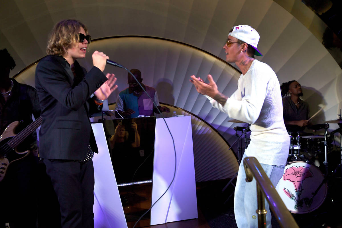 Justin Bieber performs at h.wood Group's grand openingof Delilah at Wynn Las Vegas on July 10 ...