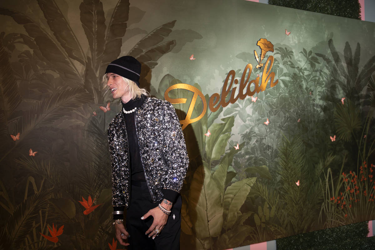 Machine Gun Kelly poses for photographers upon arrival at the grand opening party of Delilah at ...