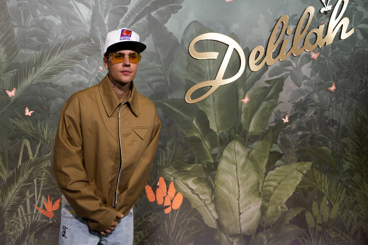 Justin Bieber poses for photographers upon arrival at the grand opening party of Delilah at Wyn ...