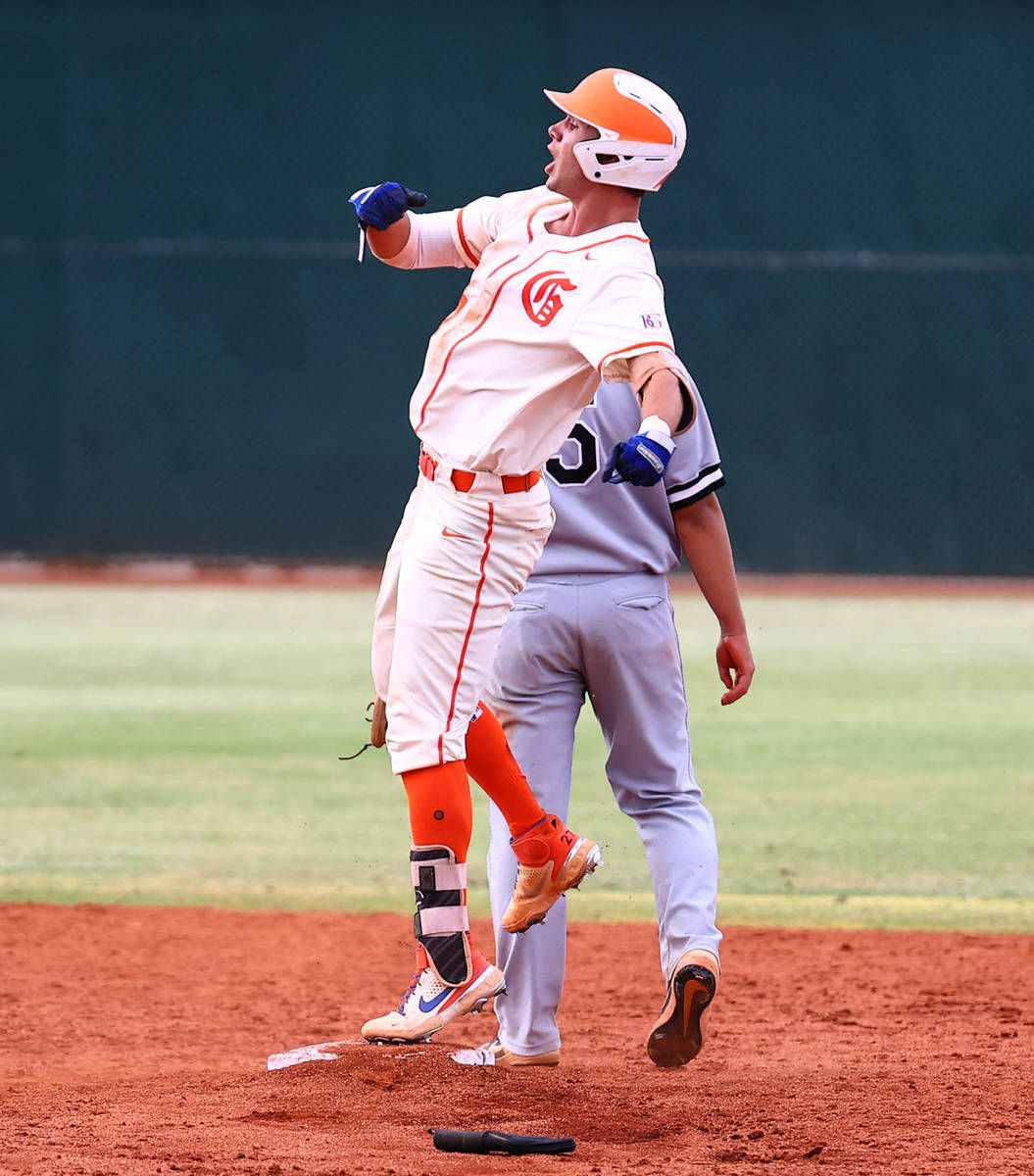 Bishop Gorman HighÕs right fielder Tyler Whitaker celebrates after hitting a double and 2r ...