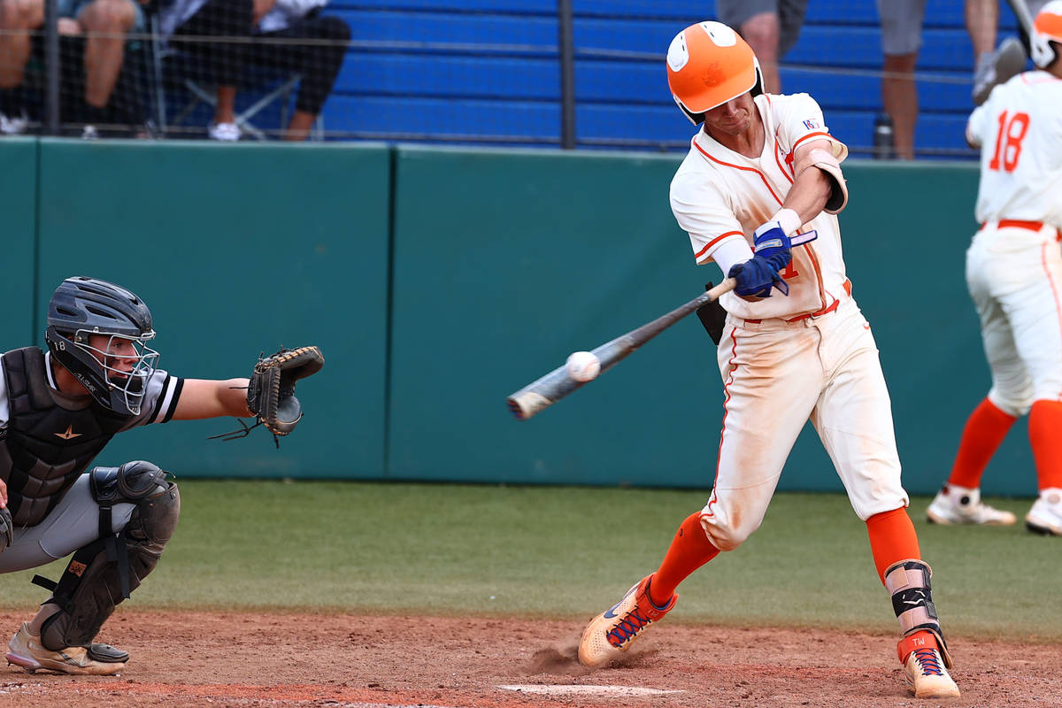 Bishop Gorman HighÕs right fielder Tyler Whitaker connects with the ball against Palo Verd ...