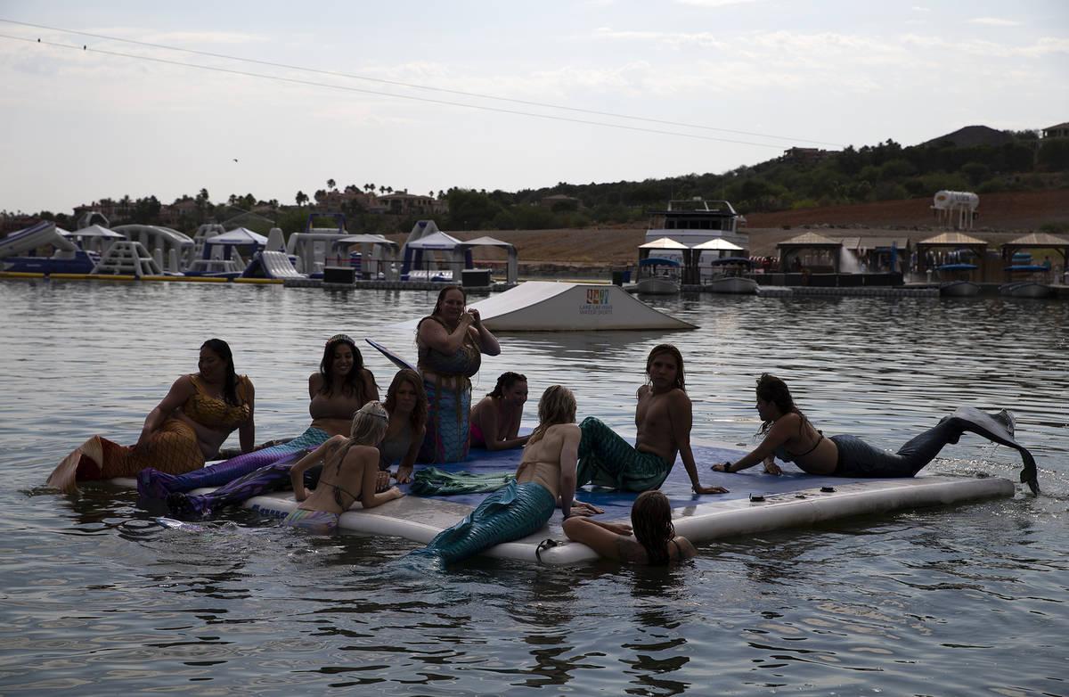 Mermaids sun themselves at Lake Las Vegas on Saturday, June 19, 2021, in Henderson. (Ellen Schm ...
