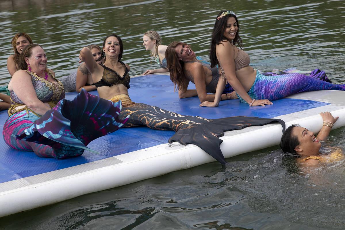 Mermaids enjoy the water at Lake Las Vegas on Saturday, June 19, 2021, in Henderson. (Ellen Sch ...