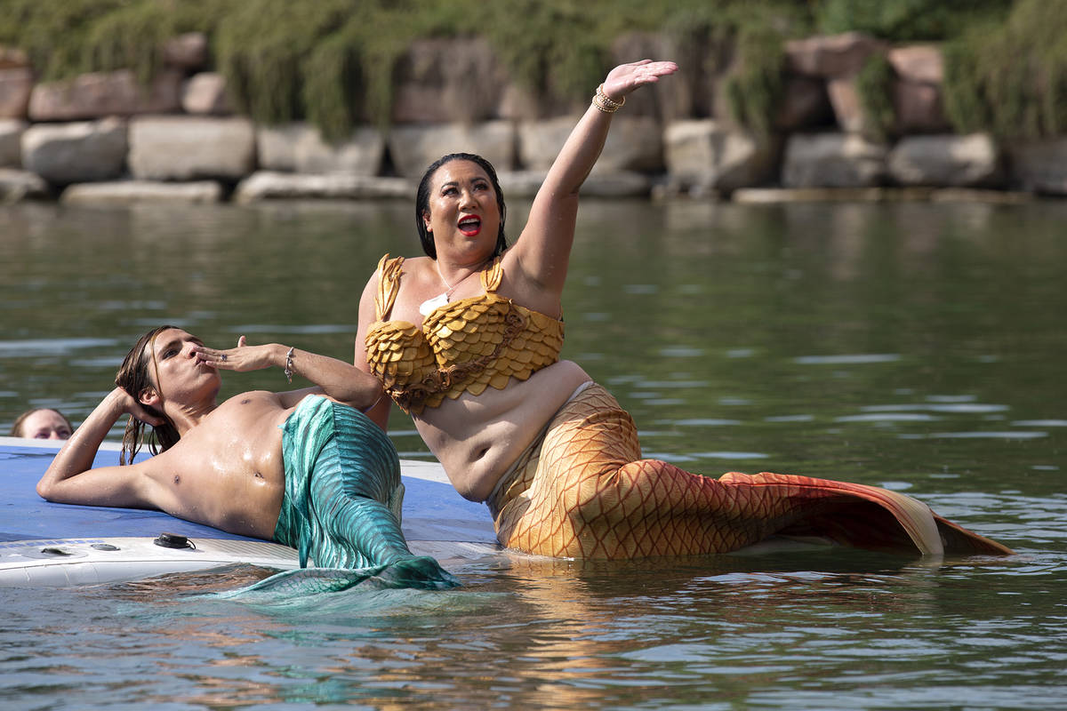 Mermaids pose for drone photos at Lake Las Vegas on Saturday, June 19, 2021, in Henderson. (Ell ...