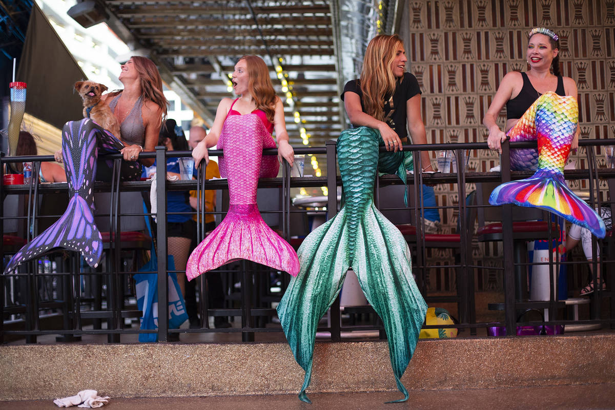 From left, mermaids Veronika Valentine, Miranda Huizing, The Traveling Merman and JJ Sin City p ...