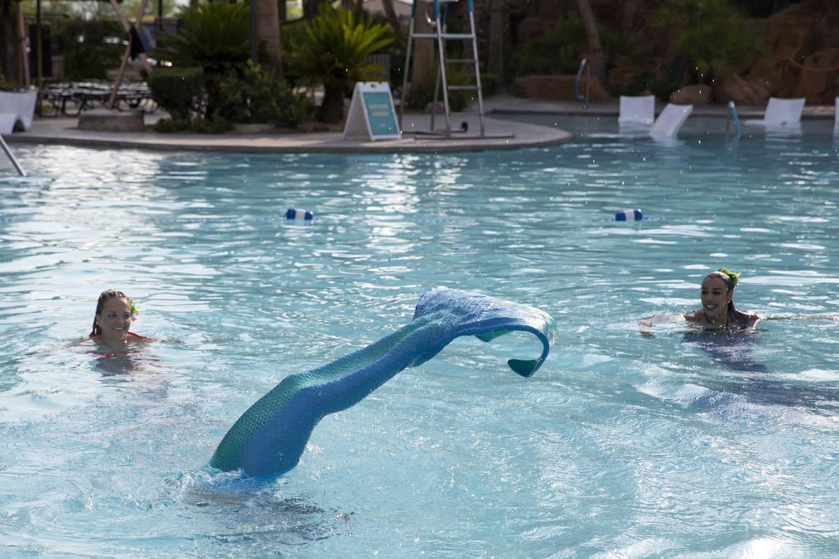 Mermaid CaySea, Casey McConachie, left, and Mermaid Luna, Jamie Rivera, right, watch as Mermaid ...
