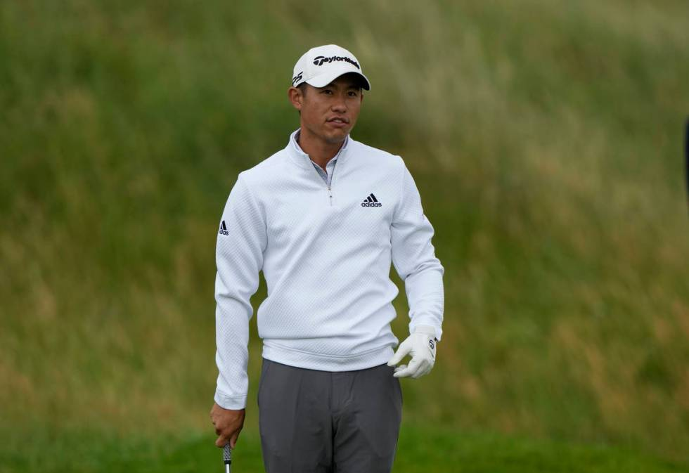 United States' Collin Morikawa look at the 2nd green after putting during a practice round for ...