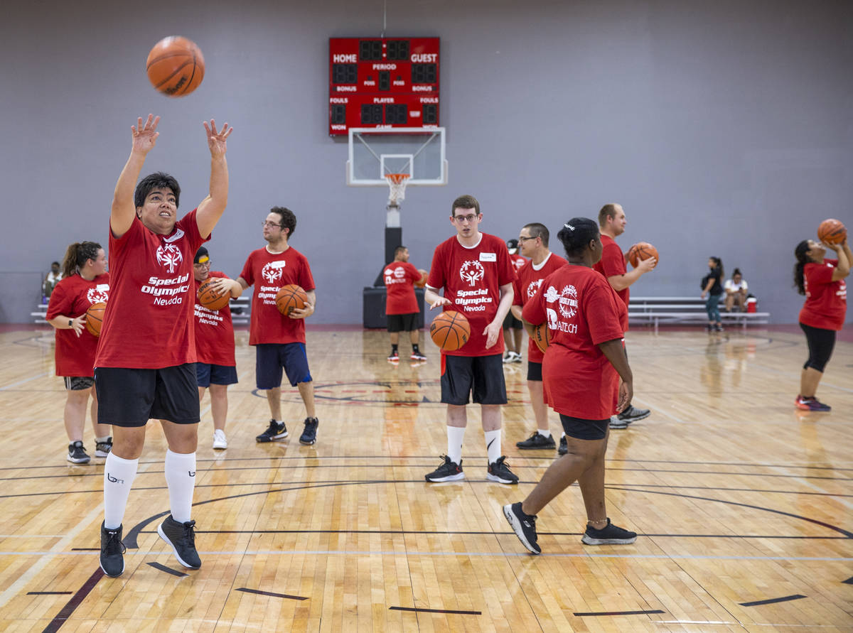 Players lukewarm  up   with immoderate   shooting arsenic  the Special Olympics Nevada hosts a hoops  session  wit ...