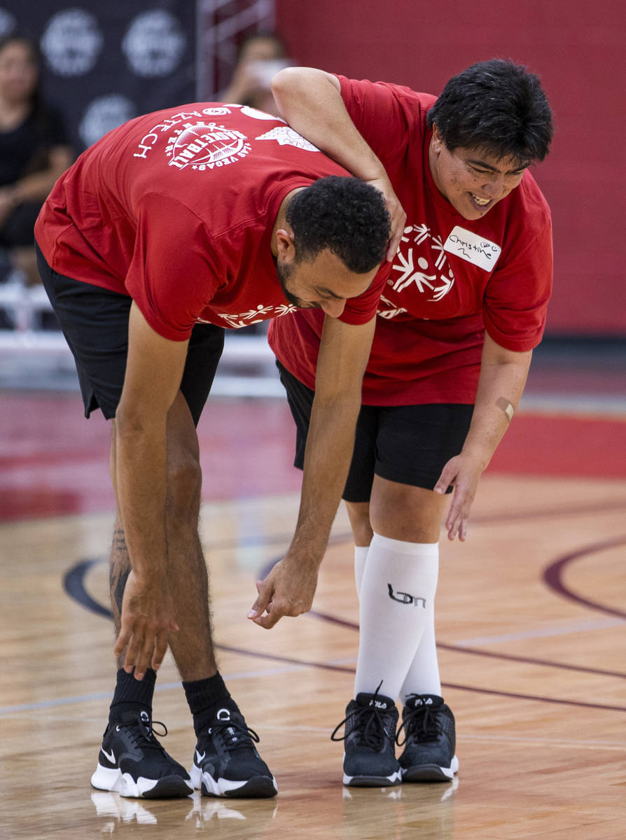 Professional hoops  subordinate    Nigel Williams-Goss, left, warms up   with young subordinate    Christine ...