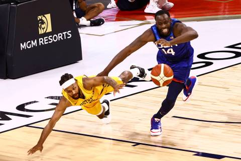 Australia's Patty Mills, left, and USA's Draymond Green (14) battle for a loose ball dur ...