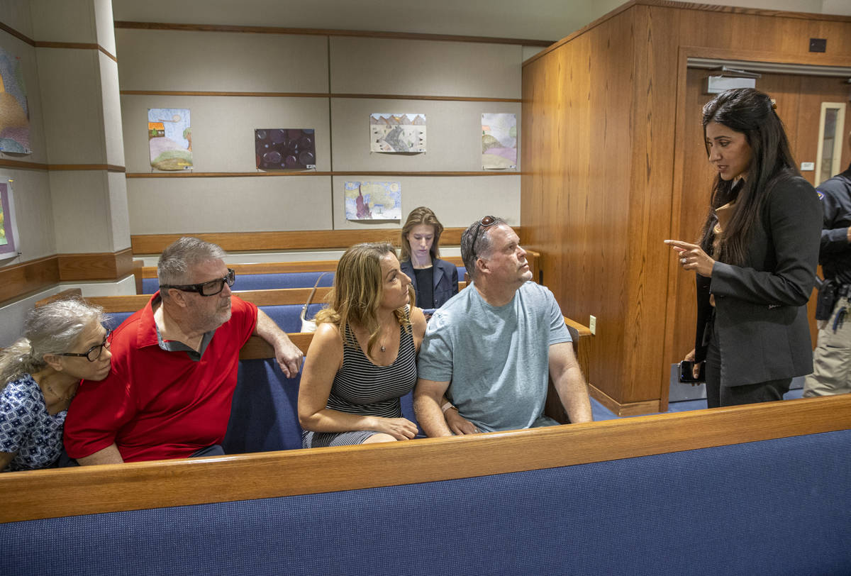 (From right) Chief Deputy District Attorney Tina Talim speaks to parents Marty and Tami Slatsky ...