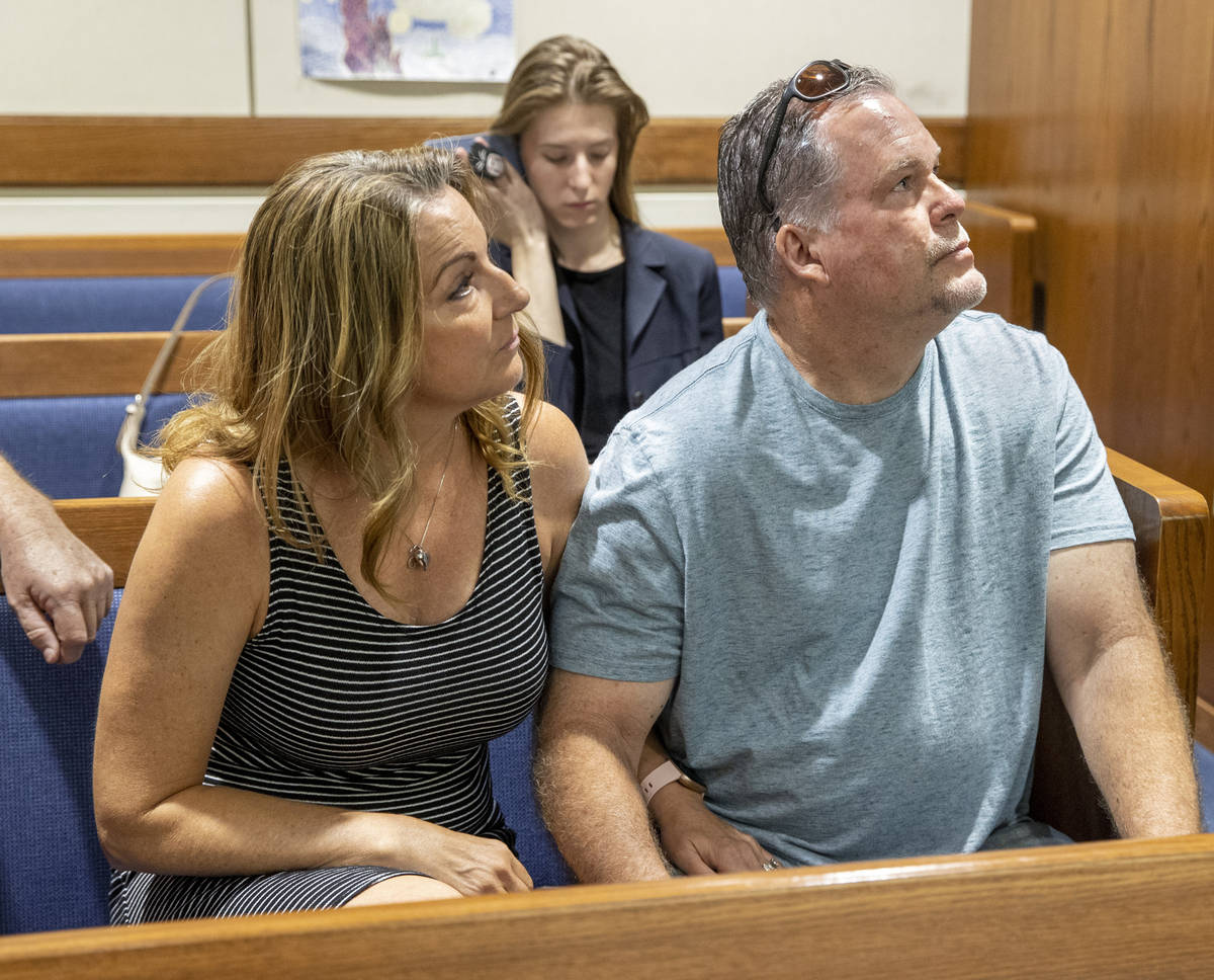 Tami and Marty Slatsky listen to Chief Deputy District Attorney Tina Talim, off right, at the c ...