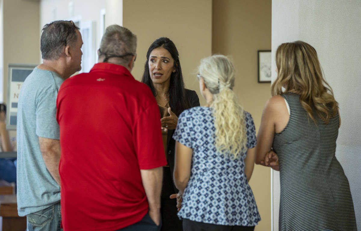Chief Deputy District Attorney Tina Talim, center, speaks to family and friends of Tiffany Slat ...