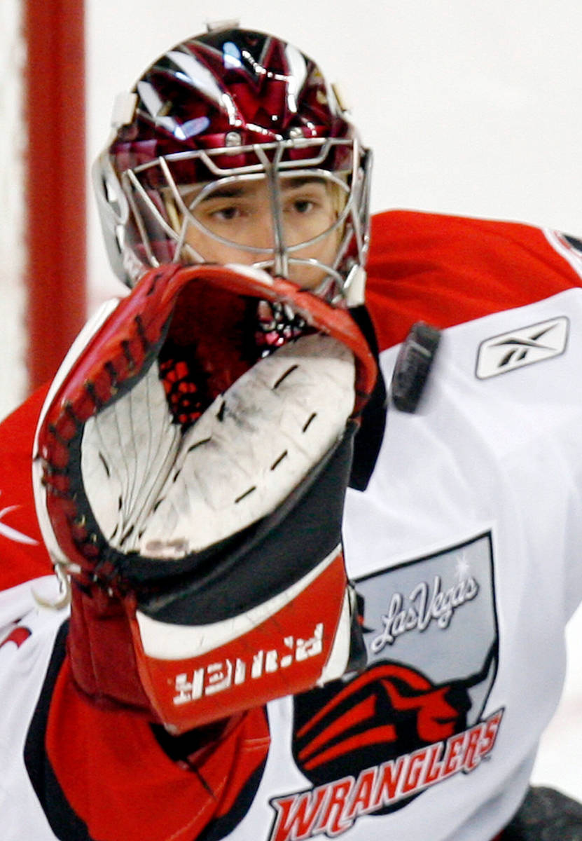 In this Nov. 3, 2006, file photo, Las Vegas Wranglers goalie Mike McKenna stops a shot from a V ...