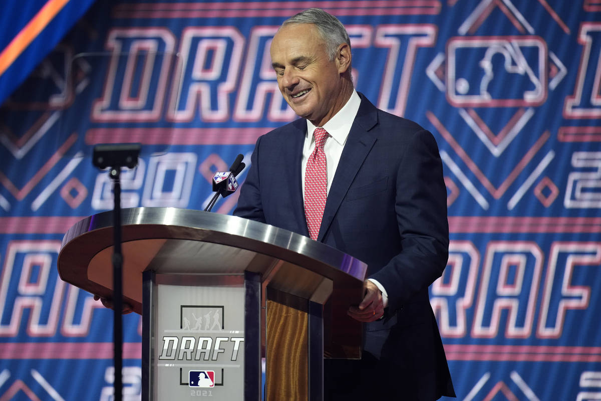 MLB Commissioner Rob Manfred reacts as he is booed by fans during the first round of the 2021 M ...