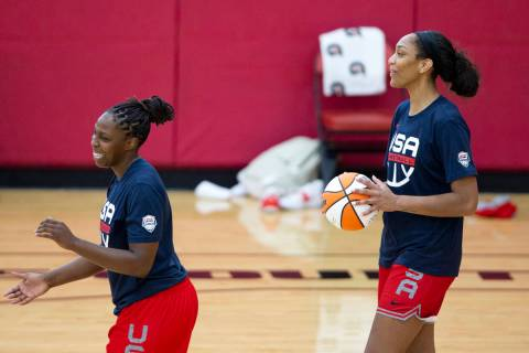 Chelsea Gray, left, and A'ja Wilson, who both play for the Las Vegas Aces in the WNBA, share a ...