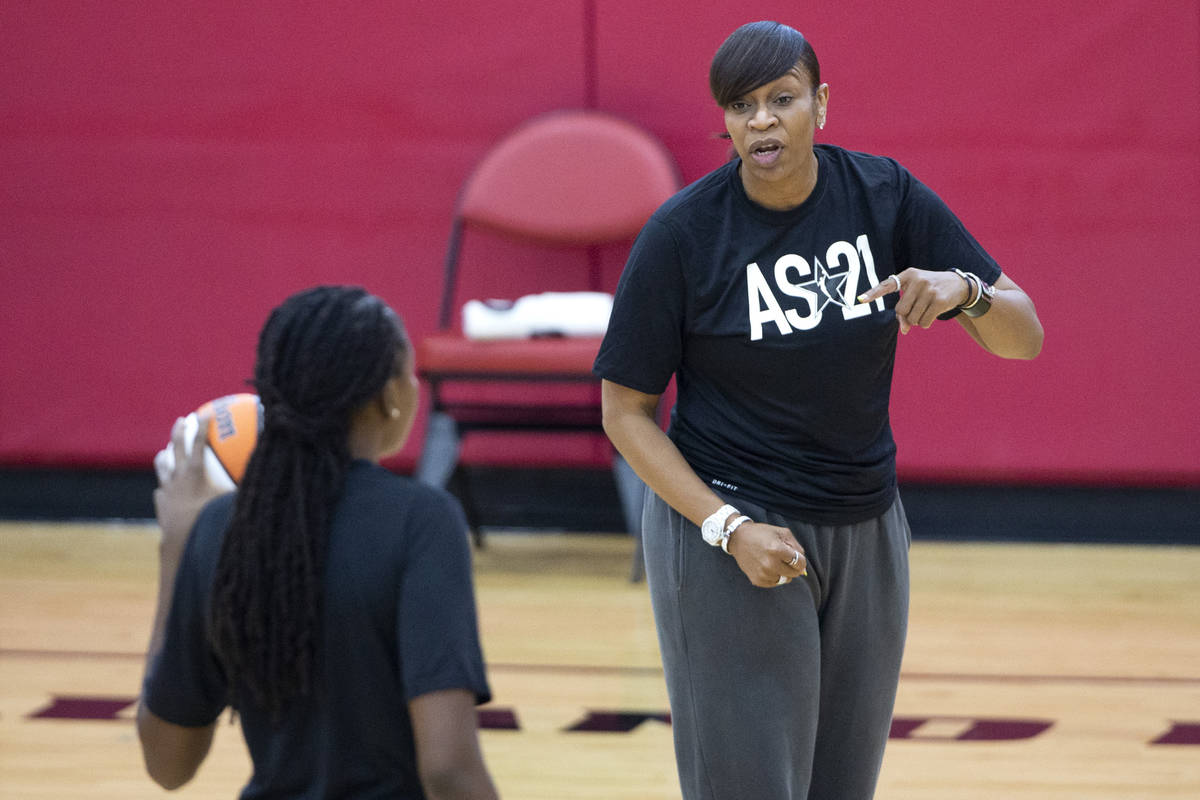 Co-head coach Tina Thompson communicates with Jonquel Jones during a 2021 Team WNBA practice in ...