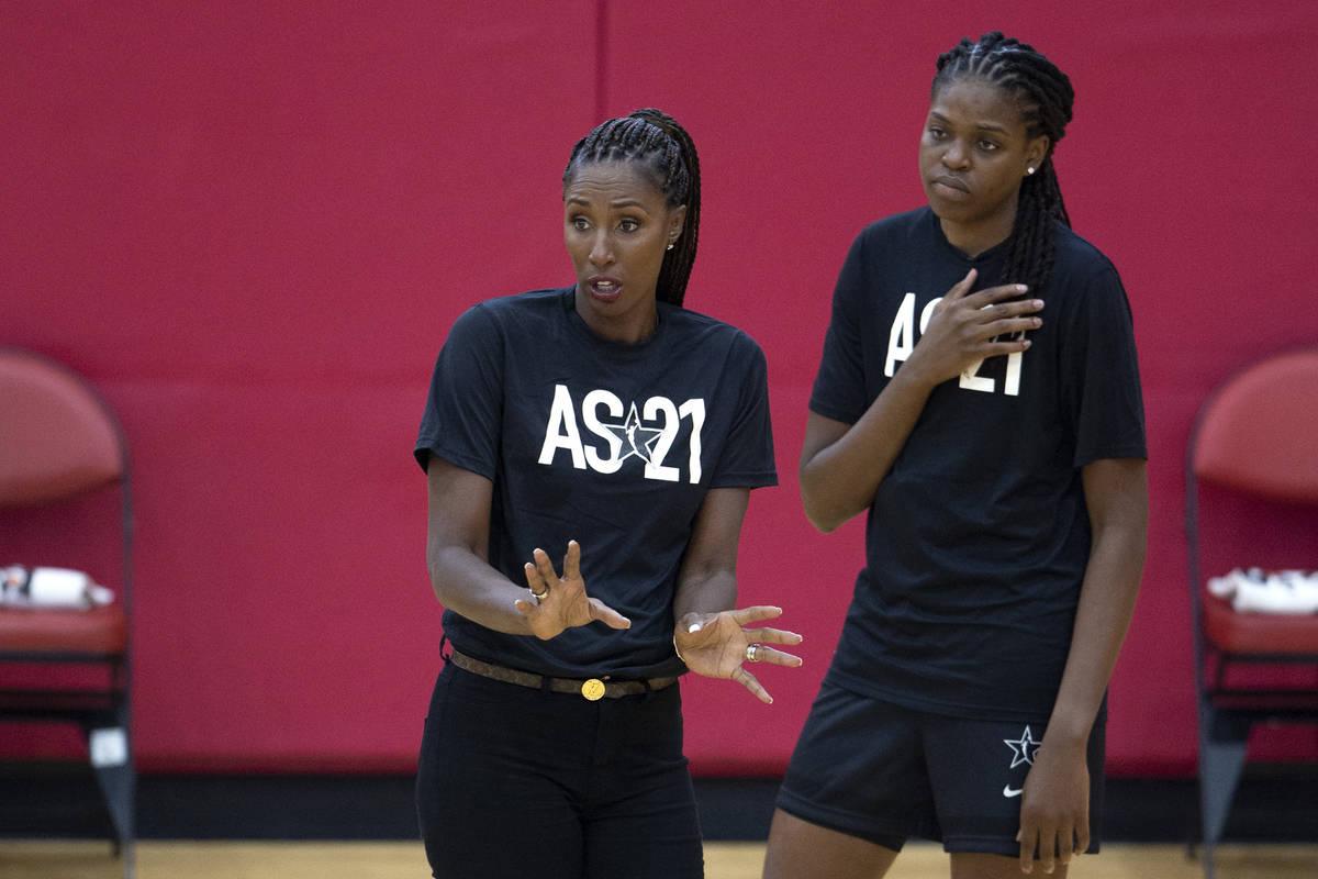 Co-head coach Lisa Leslie while Jonquel Jones listens behind her during a 2021 Team WNBA practi ...