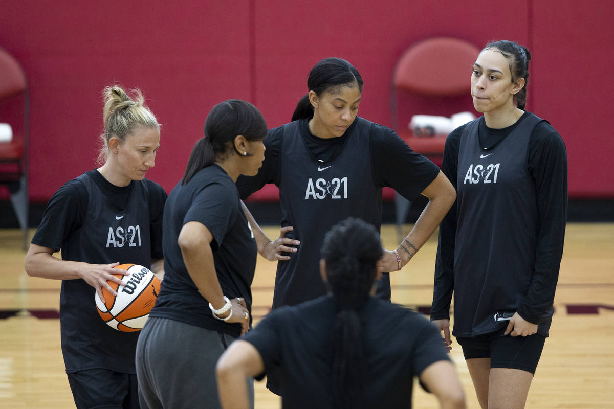 Co-head coach Tina Thompson, second from left, communicates with Courtney Vandersloot, left, Ca ...